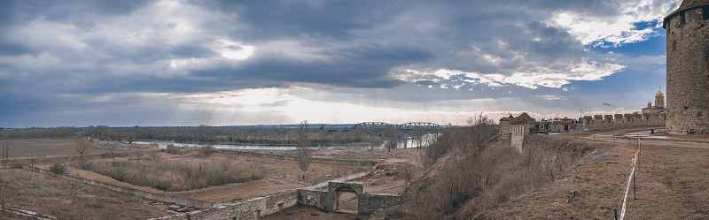 Panoramic view of the Dniester River and the arched bridge from the side of an ancient cream in Bendery Moldova photo