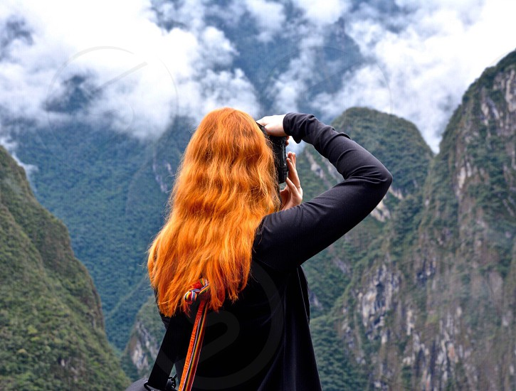 Redhead photographer shooting the Andes in Peru photo