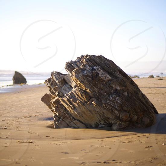stone on sand photo