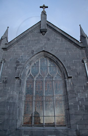 Cathedral in Galway Ireland with the reflection of another beautiful building in the window. photo