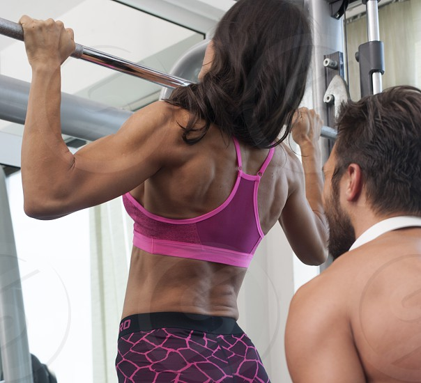 Man and woman working out photo