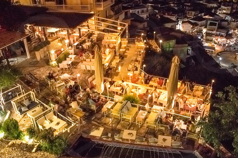 People Dining In The Outdoor Restaurant At Night photo