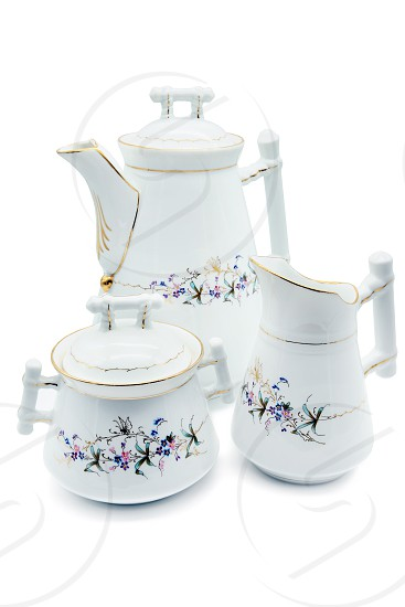 Antique Biedermeier Porcelain set of milk pot coffeepot and sugar box. butterfly and flower ornaments. photo