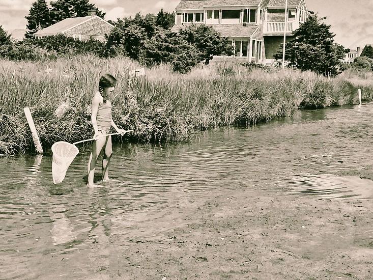 girl holding net for fishing photo