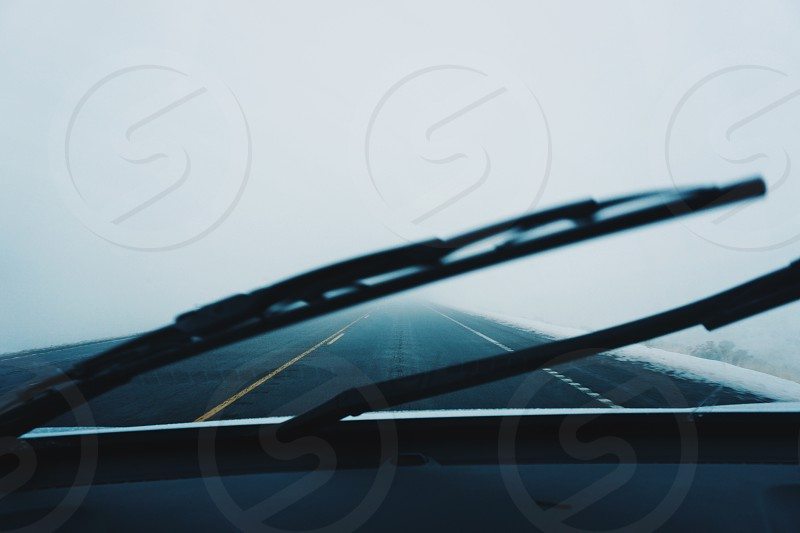 Road trip unknown fog road car pov photo