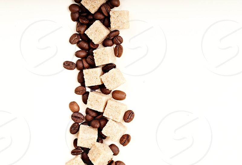 Coffee beans on paper with copyspace for your text. photo