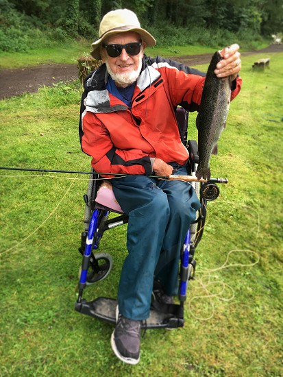 Elderly man trout fishing  photo