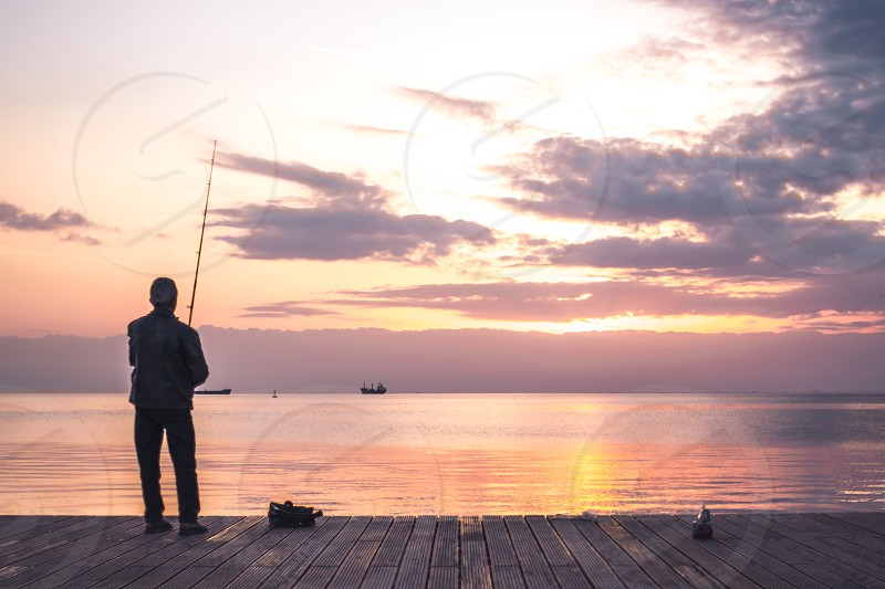 Fisherman In The Sunset photo