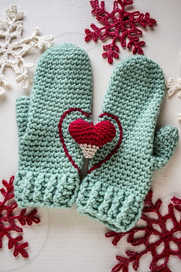 warm gloves with heart and snowflakes ❄ photo