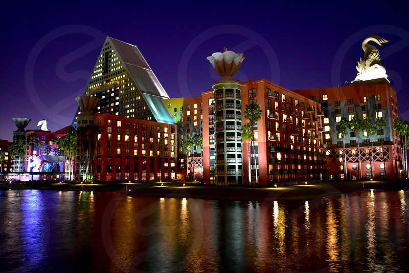 Orlando Florida. February 09 2019. Partial view of colorful Hotel on blue night background at Lake Buena Vista area . photo