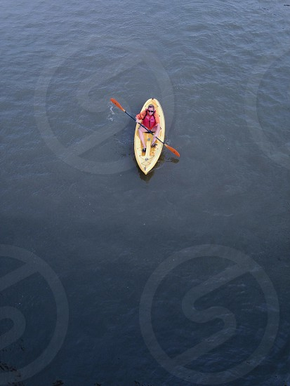man in yellow row boat photo