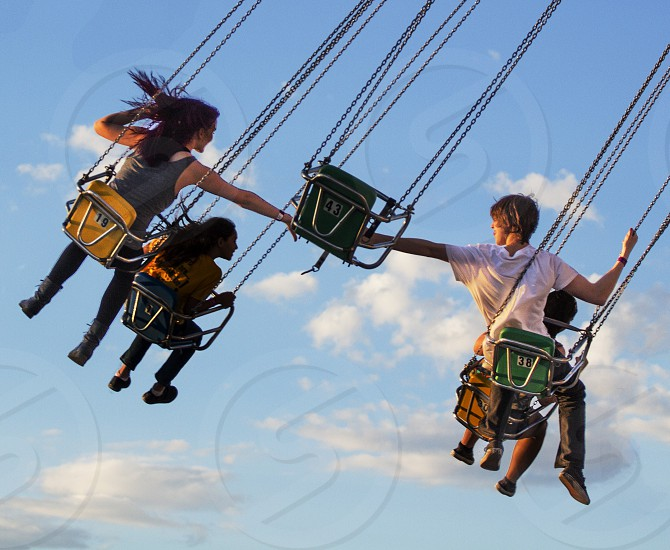 Young couple swings sky reaching love spring photo
