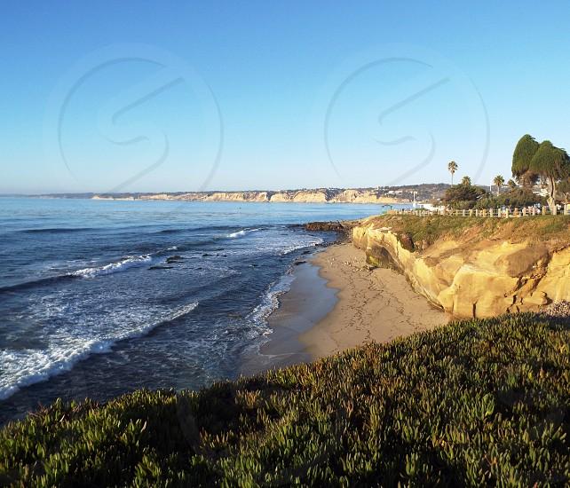 Cliff sea beach and land view in La Jolla area of San Diego CA photo