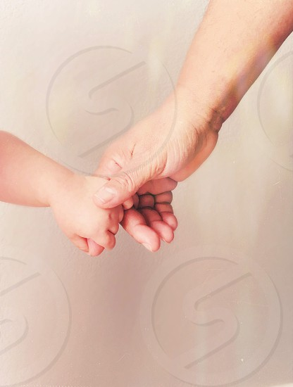 Hands grandmother toddler holding hands photo