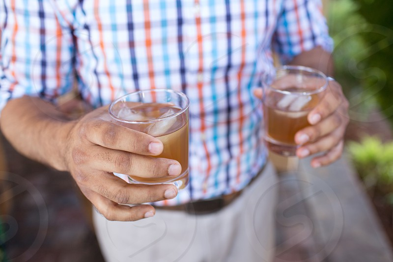 Man Holding Mixed Drinks at a Party photo
