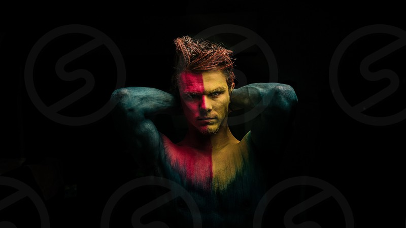 Viking warrior man male soldier mad angry intense serious focused face paint body paint men's hairstyle Viking warrior men's fashion yellow pink black portrait portraiture outdoors strength muscular gym biceps triceps abs strong photo