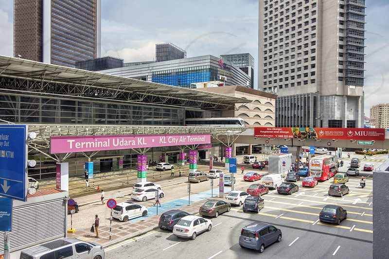 the exterior view of kl sentral in Kuala Lumpur where lrt is leaving the terminal building photo