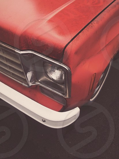 red front fender and hood of car photo