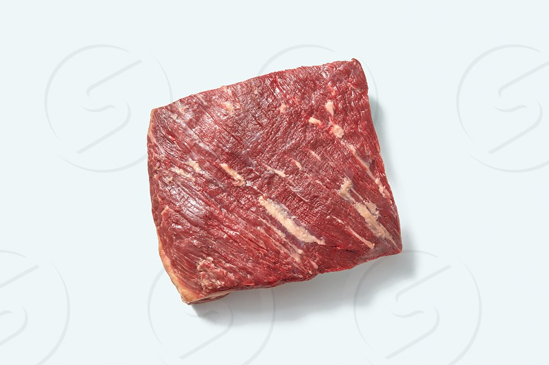 Natural fresh organicraw veal for cooking with shadows on a white background place for text. Top view. photo