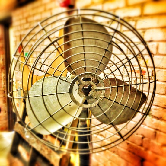 An old fan in an abandoned warehouse. photo