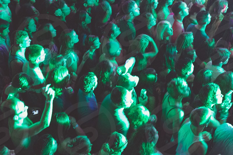 A crowd of people at a concert photo