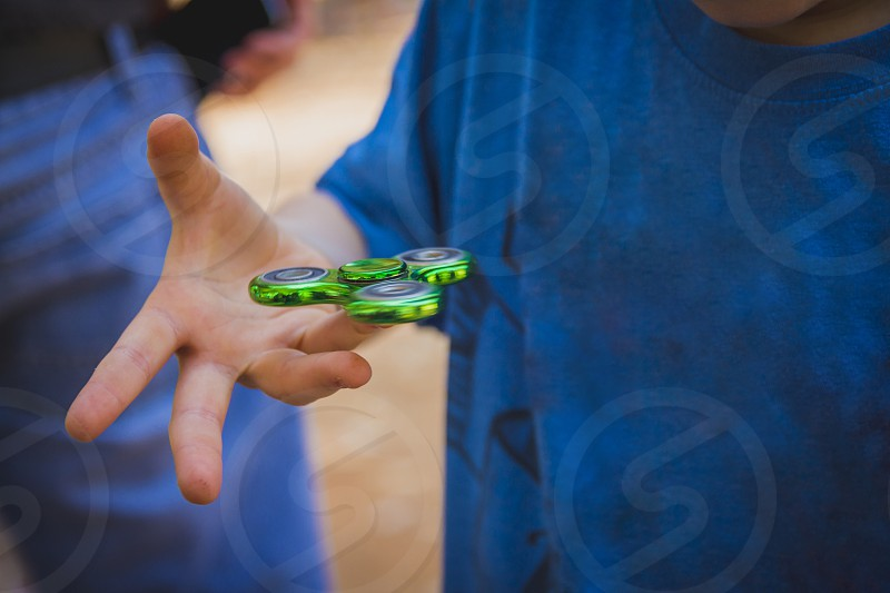 Young boy play with fidget spinner. photo