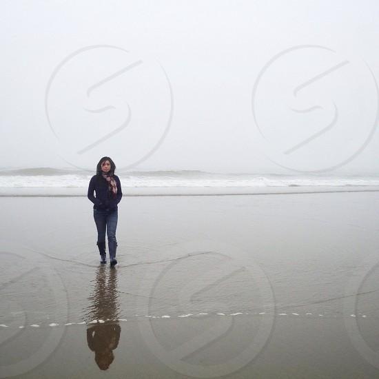 woman walking through water photo
