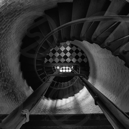 grayscale photography of whirl stairs photo