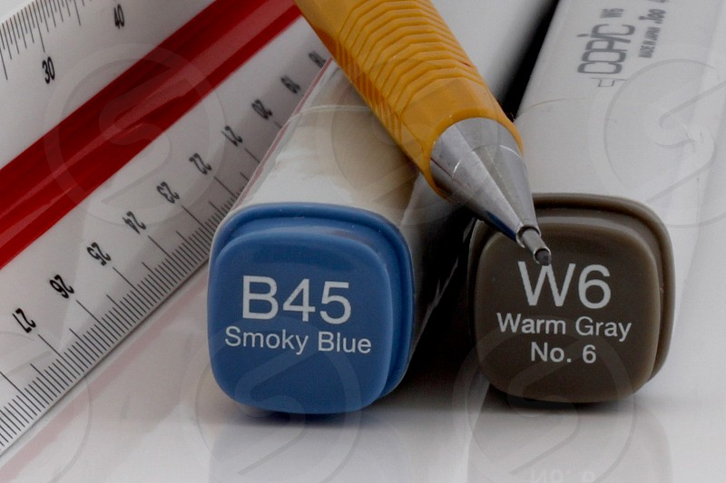 Tabletop image of tools for the interior designer  two markers a pencil and a ruler photo