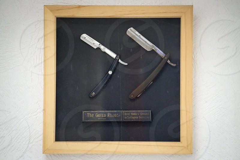 straight razors in wooden box frame photo