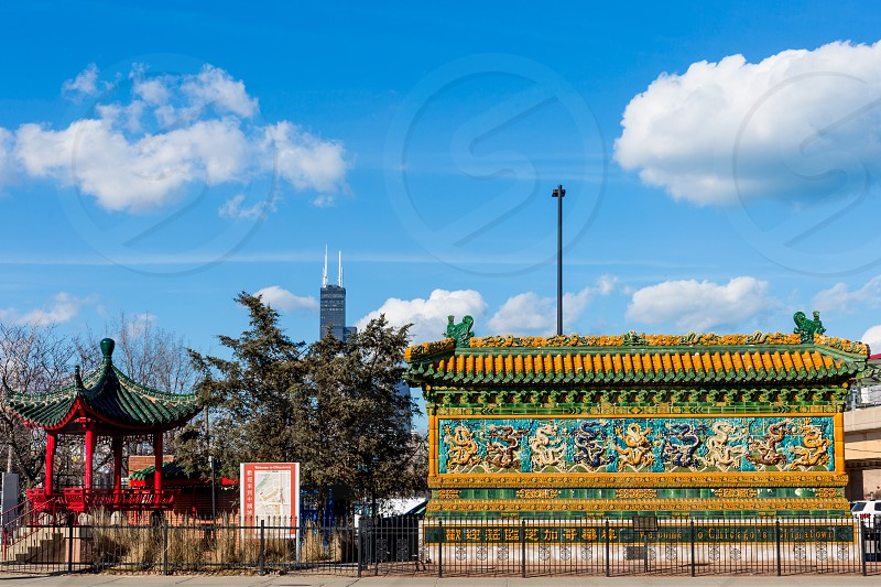 The nine dragon wall is a main attraction in Chinatown and is said to be important for impacting the neighborhoods feng shui by absorbing the negative energy from the nearby I-55 ramp.  photo