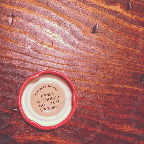 """Quote from a bottled drink cap: """"Dance as though no one is watching."""" photo"""