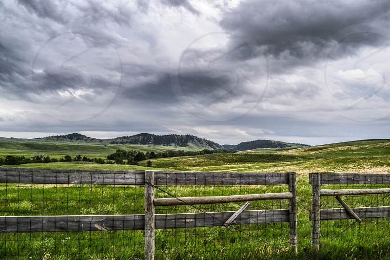 Fence and Fields in the Black Hills of South Dakota photo