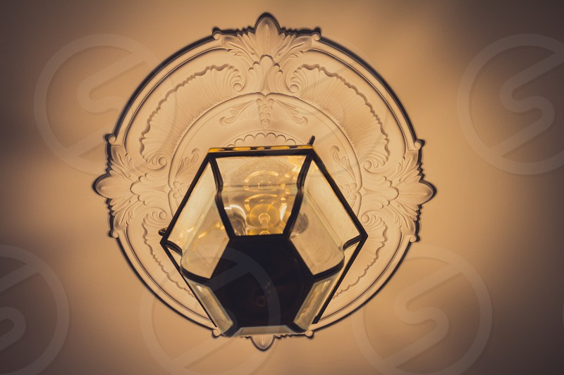 Antique lamp hanging on the ceiling photo