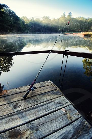 fishing dock water pole sun  photo