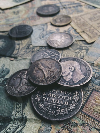 silver coins on banknotes  during daytime photo