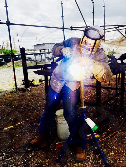 Industrial worker welder welding pipe  photo