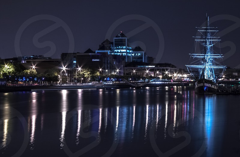 Dublin Ireland city town buildings street architecture bridge river Liffey reflection night skyline cityscape sail ship ship photo