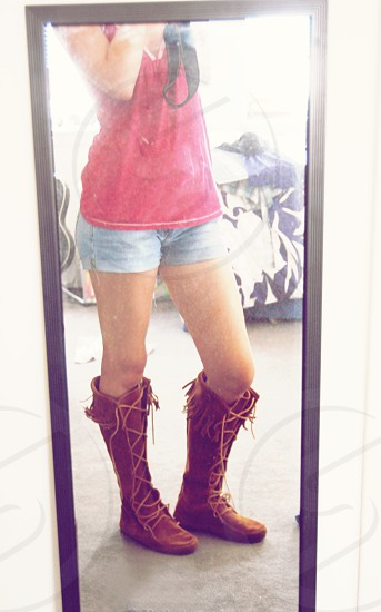 Confident girl in boots photo