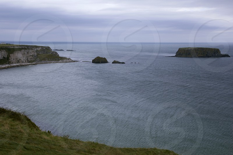 Antrim Coast Road Northern Ireland Irish Sea Autumn Bay Rocks Cliffs Waves Ripples photo