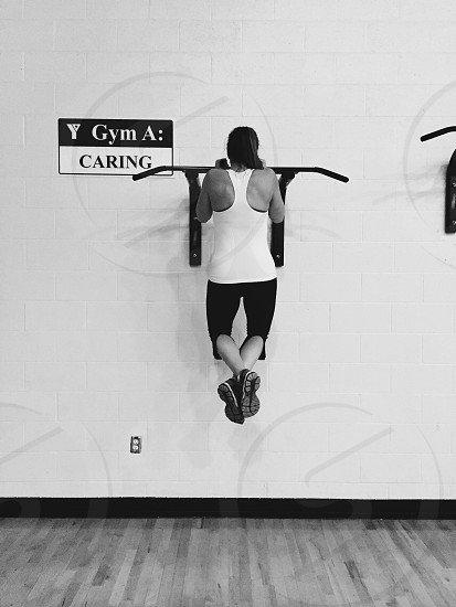 Girl gym caring ymca workout pull-up athlete health fitness photo
