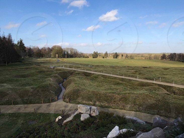 Outdoor day landscape horizontal colour Beaumont Hamel France Somme western front Battle site battleground historic historical remembrance commemoration respect WWI WW1 World War One First World War Memorial country blue trench Trenches War warfare battle grass nature trees field view photo