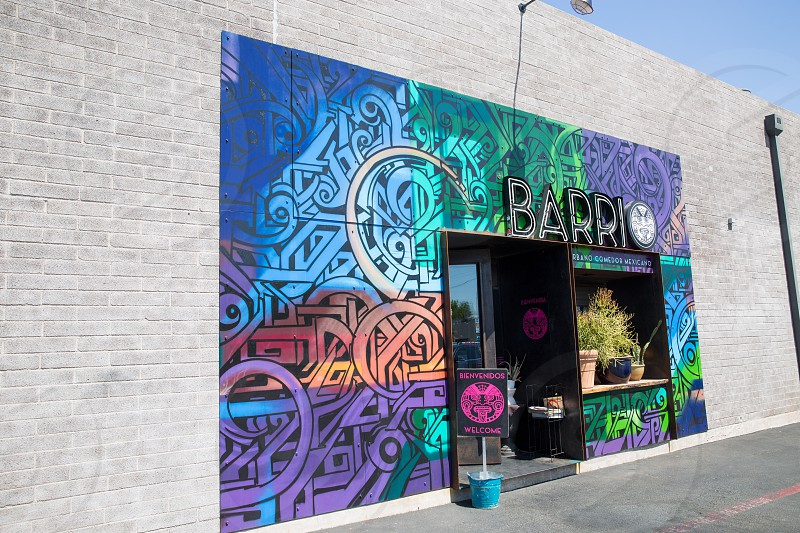 barrio entrance with blue purple green and gray graffiti painting photo