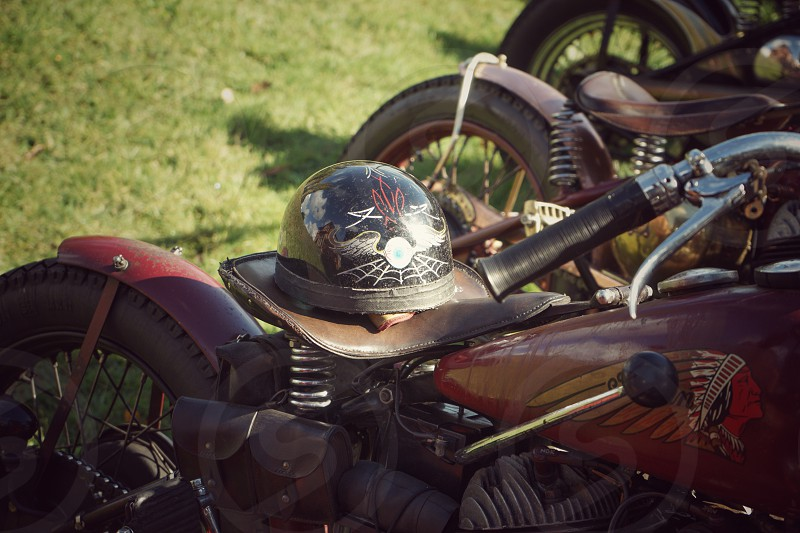 Vintage motorcycle with open face helmet on seat photo