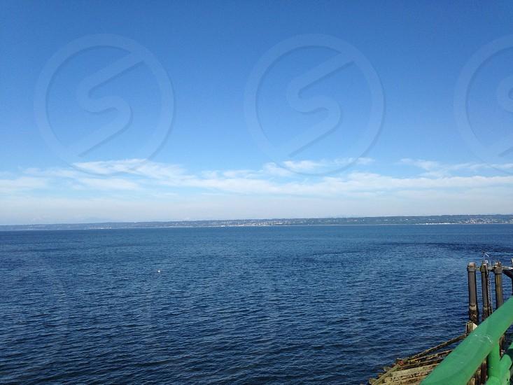 calm water ocean under blue sky photo