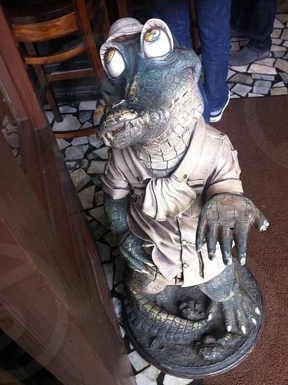 gray and black crocodile figurine photo