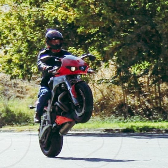 Buell motorcycle wheelie  photo