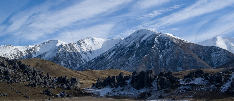 Cloud formations over Castle Hill Rocks South Island New Zealand photo