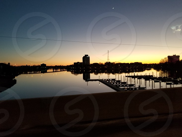 waterfront city skyline at dusk photo
