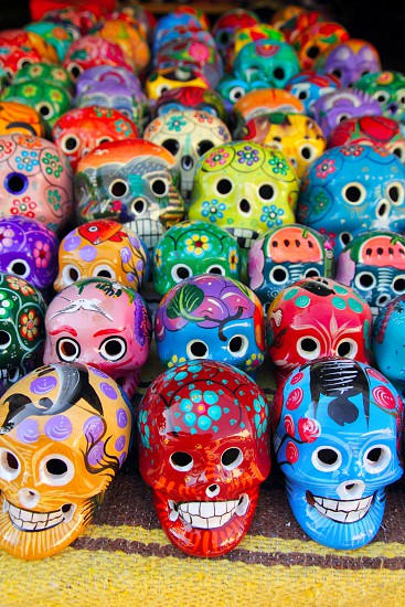 Aztec colorful skulls handcrafts from Mexican Day of the Dead photo